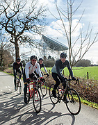 Cyclists in Cheshire passing the world famous telescope Jodrell Bank.