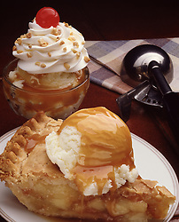 apple pie ala mode ice cream butterscotch sundae sunday whipped cream cherry hand scoop napkin nuts sprinkle vanilla