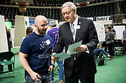 David Cottrill receives two 1st place award ribbons from Ohio University President Duane Nellis during the 2018 Student Research Expo.