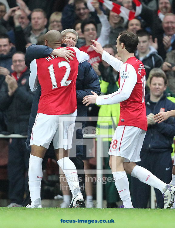 Picture by Paul Terry/Focus Images Ltd. 07545642257.09/01/12.Thierry Henry of Arsenal celebrates with team mates and manager, Arsene Wenger after he scores the first goal during the FA Cup third round match at Emirates Stadium, London.