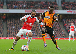 Theo Walcott of Arsenal and Moses Odubajo of Hull City challenge for the ball - Mandatory byline: Paul Terry/JMP - 20/02/2016 - FOOTBALL - Emirates Stadium - London, England - Arsenal v Hull City - FA Cup Fifth Round