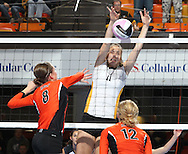 Waverly-Shell Rock's Kelsey Roggemann (11) tries to block a shot by West Delaware's Allison Pasker (8) as West Delaware's Jenna Hermsen (12) looks on during the first game of a 3A semifinal in the state volleyball tournament at the U.S. Cellular Center at 370 1st Ave E on Friday afternoon, November 12, 2010. (Stephen Mally/Freelance)