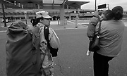 Awilda Vasquez carries her duffle bag to the airport terminal while her mother Ligia holds her 4-year-old daughter Emily. Vasquez is flying back to  Iraq after a 2 week leave of her 12 month deployment.