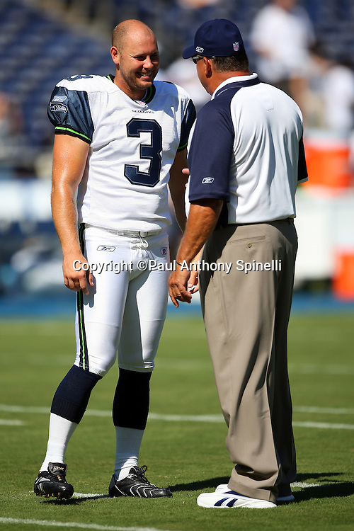 SAN DIEGO, CA - AUGUST 12:  Kicker Josh Brown of the Seattle Seahawks talks to a coach during pregame warmups against the San Diego Chargers during the NFL preseason game on August 12, 2007 at Qualcomm Stadium in San Diego, California. The Seahawks defeated the Chargers 24-16. ©Paul Anthony Spinelli *** Local Caption *** Josh Brown