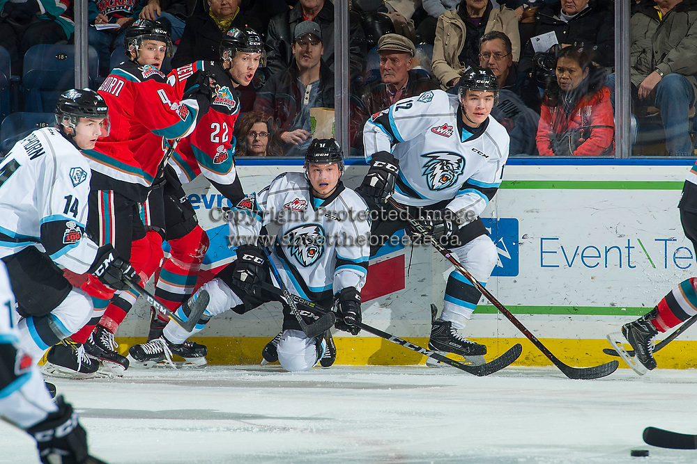 KELOWNA, CANADA - DECEMBER 2: Gordie Ballhorn #4 and Braydyn Chizen #22 of the Kelowna Rockets check Gilian Kohler #17 and Cole Muir #12 of the Kootenay Ice at the boards on December 2, 2017 at Prospera Place in Kelowna, British Columbia, Canada.  (Photo by Marissa Baecker/Shoot the Breeze)  *** Local Caption ***