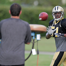 04 August 2009: New Orleans Saints linebacker Jonathan Vilma (51) works on catching passes during New Orleans Saints training camp at the team's practice facility in Metairie, Louisiana.