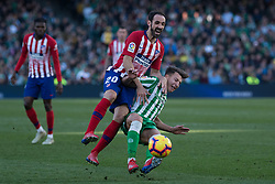 February 3, 2019 - Sevilla, Andalucia, Spain - Francis of Real Betis and Juanfran of Atletico de Madrid competes for the ball during the LaLiga match between Real Betis vs Atletico de Madrid at the Estadio Benito Villamarin in Sevilla, Spain. (Credit Image: © Javier MontañO/Pacific Press via ZUMA Wire)