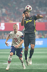 August 1, 2018 - Atlanta, Georgia, United States - Juventus midfielder EMRE CAN, 23 heads the ball while MLS All-Star midfielder ALEXANDER RING looks on during the 2018 MLS All-Star Game at Mercedes-Benz Stadium in Atlanta, Georgia.   Juventus F.C. defeats  MLS All-Stars defeat  1 to 1  (Credit Image: © Mark Smith via ZUMA Wire)