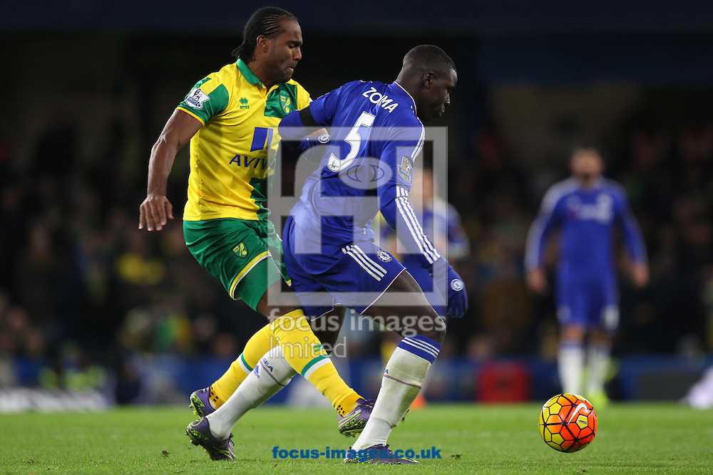Cameron Jerome of Norwich and Kurt Zouma of Chelsea in action during the Barclays Premier League match at Stamford Bridge, London<br /> Picture by Paul Chesterton/Focus Images Ltd +44 7904 640267<br /> 21/11/2015