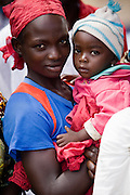 Refugee woman and her child from Central African Republic waiting for food distribution at the Garga Sarali integrated health center in the town of Garga Sarali, near Bertoua, Cameroon, on Tuesday September 15, 2009.