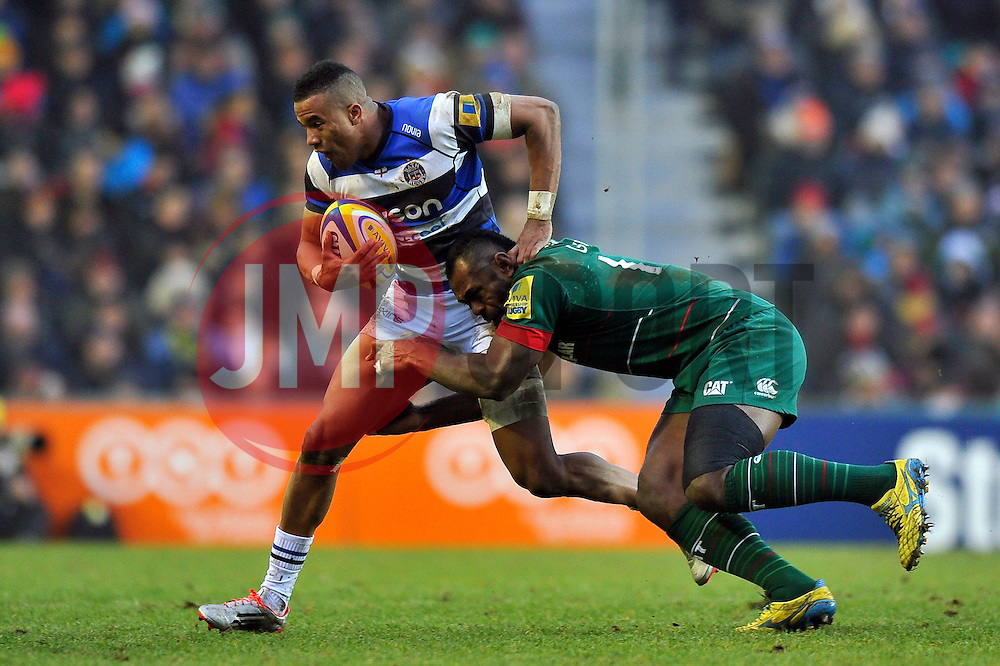 Anthony Watson of Bath Rugby is tackled by Vereniki Goneva of Leicester Tigers - Photo mandatory by-line: Patrick Khachfe/JMP - Mobile: 07966 386802 04/01/2015 - SPORT - RUGBY UNION - Leicester - Welford Road - Leicester Tigers v Bath Rugby - Aviva Premiership