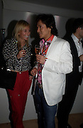 Marguerite Wennberg and Andy Wong.  Remi and Olivier Krug host the Krug Rose celebration. Debenham Place, 8 Addison Rd. London W14. 28 June 2005. ONE TIME USE ONLY - DO NOT ARCHIVE  © Copyright Photograph by Dafydd Jones 66 Stockwell Park Rd. London SW9 0DA Tel 020 7733 0108 www.dafjones.com