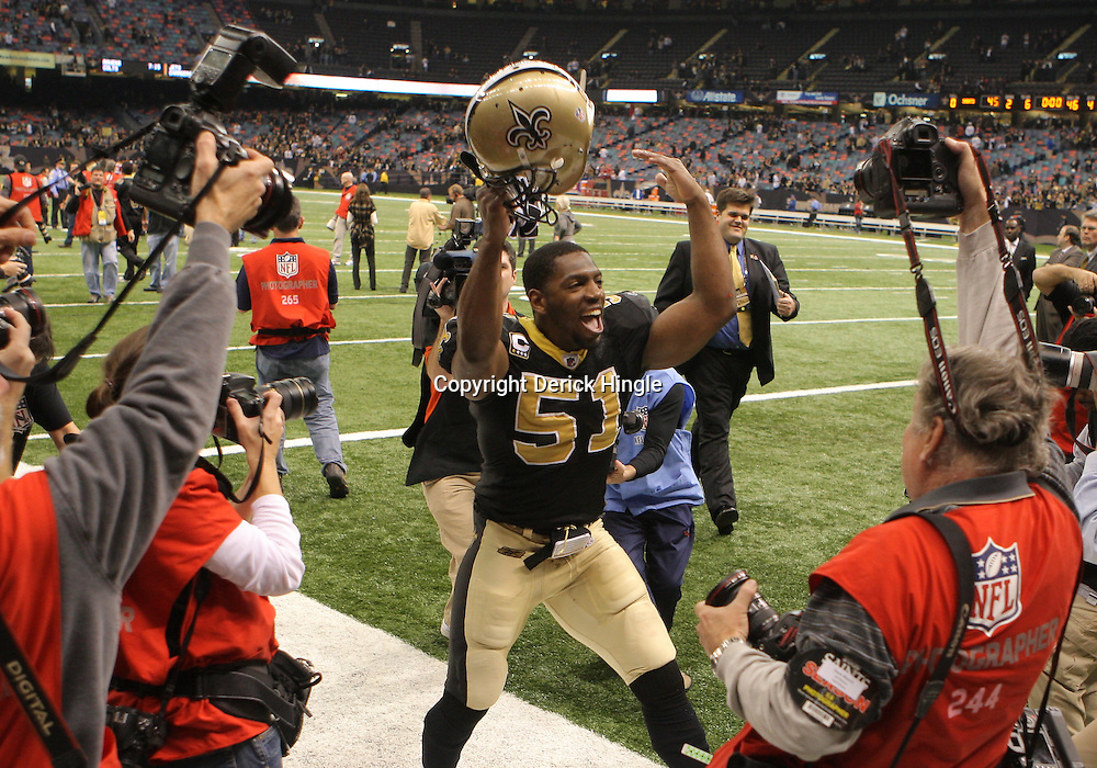 16 January 2010: New Orleans Saints linebacker Jonathan Vilma (51) celebrates following a 45-14 win by the New Orleans Saints over the Arizona Cardinals in the 2010 NFC Divisional Playoff game at the Louisiana Superdome in New Orleans, Louisiana.