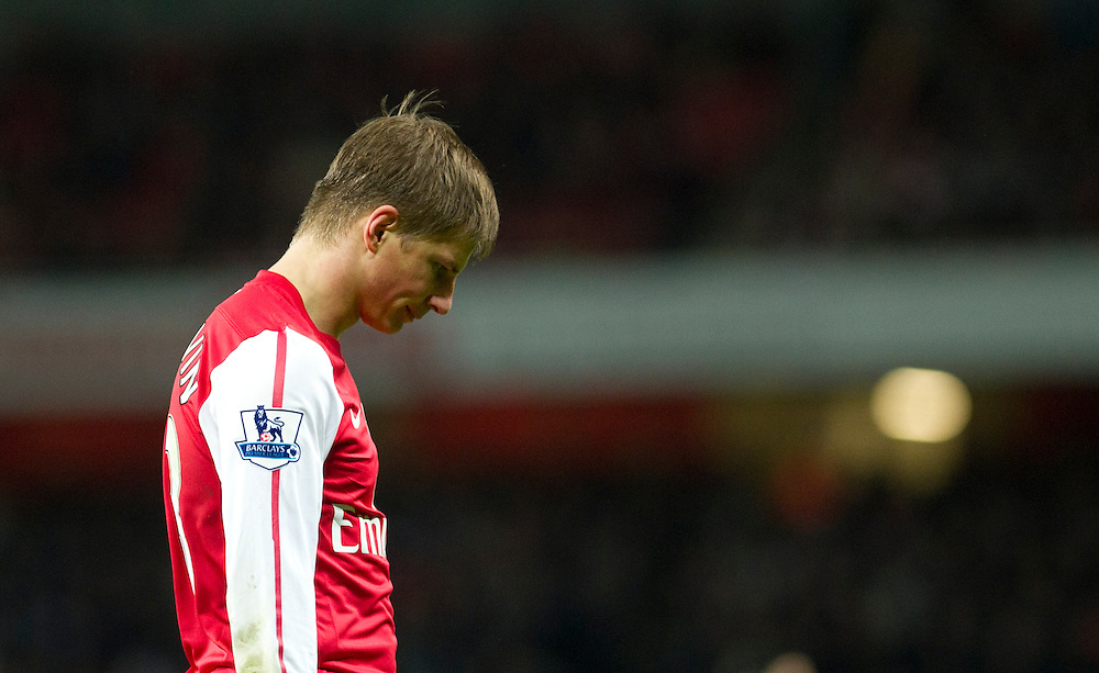 Arsenal's Andrey Arshavin reacts during  their English Premier League soccer match against Fulham, at the  Emirates stadium in London, Saturday, Nov. 26, 2011. (AP Photo/Bogdan Maran)