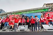 19 MAY 2013 - BANGKOK, THAILAND:    Red Shirt leaders take the stage during a Red Shirt rally in Ratchaprasong Intersection honoring Red Shirts killed by the Thai army in 2010. More than 85 people, most of them civilians, were killed during the Thai army crackdown against the Red Shirt protesters in April and May 2010. The Red Shirts were protesting against the government of Abhisit Vejjajiva, a member of the opposition who became Prime Minister after Thai courts ruled the Red Shirt supported government was unconstitutional. The protests rocked Bangkok from March 2010 until May 19, 2010 when Thai troops swept through the protest areas arresting hundreds.   PHOTO BY JACK KURTZ