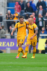 Newport County's Andy Sandell celebrates his goal with Newport County's David Pipe  - Photo mandatory by-line: Dougie Allward/JMP - Tel: Mobile: 07966 386802 17/08/2013 - SPORT - FOOTBALL - Rodney Parade - London - Newport County V Bristol Rovers - Sky Bet league two