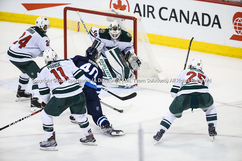WINNIPEG, MB – April 11: Winnipeg Jets forward Joel Armia (40) is stopped by Minnesota Wild goalie Devan Dubnyk (40) during the Stanley Cup Playoffs First Round Game 1 between the Winnipeg Jets and the Minnesota Wild on April 11, 2018 at the Bell MTS Place in Winnipeg MB. (Photo by Terrence Lee/Icon Sportswire)