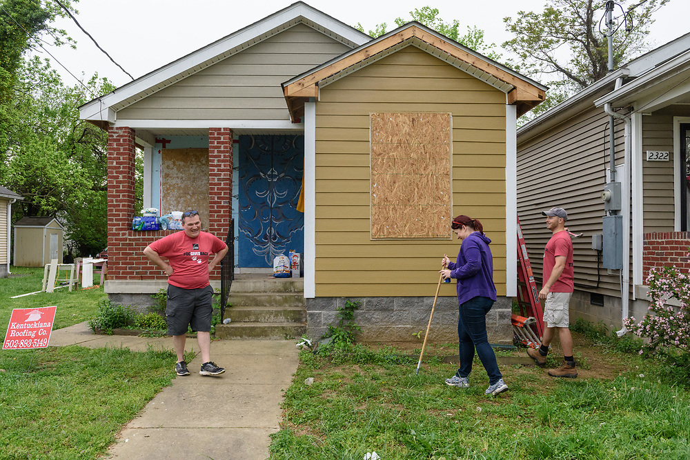 A group of Owens-Corning employees work at a Habitat for Humanity build Friday, April 21, 2017, at 2320 St. Louis Ave. in Louisville, Ky. (Photo by Brian Bohannon)