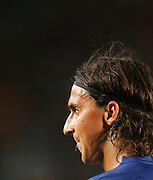 Barcelona's Zlatan Ibrahimovic spits whilst he makes his debut at the Nou Camp during their 44th Trophy Joan Gamper friendly football match against Manchester City at Camp Nou stadium in Barcelona on August 19, 2009.