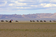 GOBI DESERT, MONGOLIA..08/26/2001.Bayangovi. Local Naadam festival. Motorcycle escort for horse race over 30 kilometers..(Photo by Heimo Aga).