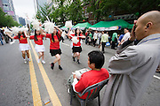 The annual Lotus Lantern Festival is held to celebrate Buddha's Birthday. Cheerleaders trained by a buddhist monk.