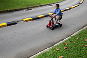A man rides a personal motioned vehicle on the road at Ang Mo Kio, Singapore.