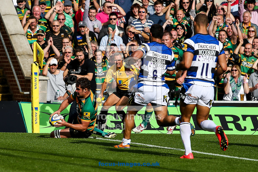 Calum Clark of Northampton Saints (left) goes over for a try during the Aviva Premiership match at Franklin's Gardens, Northampton<br /> Picture by Andy Kearns/Focus Images Ltd 0781 864 4264<br /> 27/09/2014