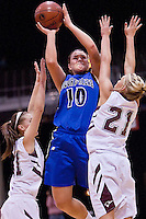 JEROME A. POLLOS/Press..Coeur d'Alene High's Kama Griffitts goes up for a shot between two Centennial High defenders during the second half of the 5A state championship game. Griffitts finished the game with 22 points and 13 rebounds.