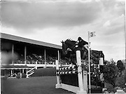 "07/08/1962 <br /> 08/07/1962 <br /> 07 August 1962 <br /> Dublin Horse show at the RDS, Ballsbridge, Dublin, Tuesday. Image shows  Geogre Stewart of Lisburn on ""Shady Nook"", taking a jump in Competition ""A"" (children) over special course, finishing with a clear round to share 1st place with six others."