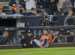 October 18, 2017 - Bronx, NY, USA - Houston Astros second baseman Jose Altuve sits at the top of the dugout steps watching the ninth inning of a 5-0 loss against New York Yankees during Game 5 of the American League Championship Series at Yankee Stadium in New York on Wednesday, Oct. 18, 2017. The Yankees' win gives them a 3-2 series lead. (Credit Image: © Howard Simmons/TNS via ZUMA Wire)
