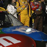 NASCAR Sprint Cup driver Kyle Busch (18) is seen with Samantha Sarcinella prior to the NASCAR Sprint Unlimited Race at Daytona International Speedway on Saturday, February 16, 2013 in Daytona Beach, Florida.  (AP Photo/Alex Menendez)
