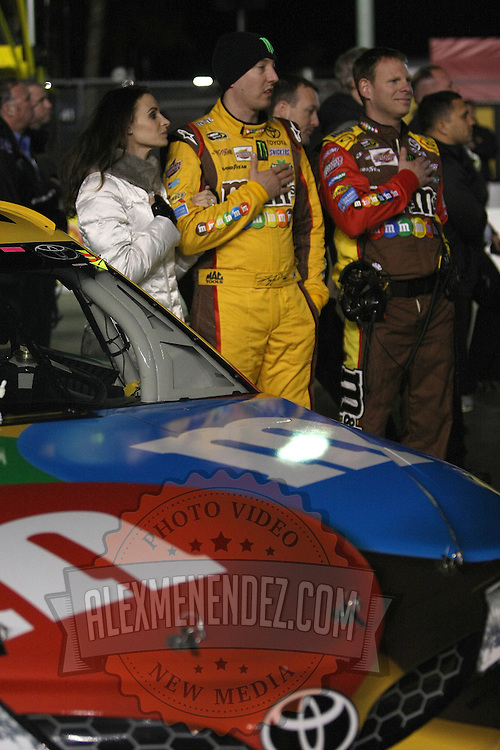 NASCAR Sprint Cup driver Kyle Busch (18) is seen with Samantha Sarcinella prior to the NASCAR Sprint Unlimited Race at Daytona International Speedway on Saturday, February 16, 2013 in Daytona Beach, Florida.  (AP Photo/Alex Menendez)