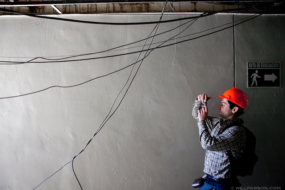 UCSD grad student Yannis Koutromanos takes a photo of damage inside the Mexicali federal building. Researchers led by Dr. Benson Shing, Vice Chair of the Department of Structural Engineering at the University of California, San Diego, inspected the earthquake damage in Mexicali, Mexico, April 7, 2010. A 7.2 magnitude earthquake in Baja California on Easter Sunday was felt as far away as Los Angeles.