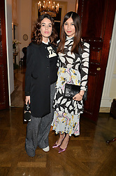 Left to right, GALA GORDON and GEMMA CHAN at a party to kick off London Fashion Week hosted by US Ambassador Matthew Barzun and Mrs Brooke Brown Barzun with Alexandra Shulman in association with J.Crew hrld at Winfield House, Regent's Park, London on 18th September 2015.