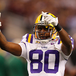 Jan 7, 2011; Arlington, TX, USA; LSU Tigers wide receiver Terrence Toliver (80) pumps up the crowd prior to kickoff of the 2011 Cotton Bowl against the Texas A&M Aggies at Cowboys Stadium.  Mandatory Credit: Derick E. Hingle