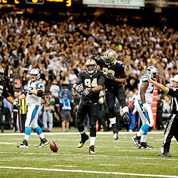 Dec 8, 2013; New Orleans, LA, USA; New Orleans Saints defensive end Cameron Jordan (94) celebrates with teammate outside linebacker Junior Galette (93) after sacking Carolina Panthers quarterback Cam Newton (not pictured) during the first half of a game at Mercedes-Benz Superdome. Mandatory Credit: Derick E. Hingle-USA TODAY Sports