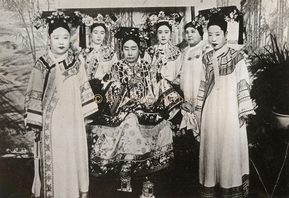 Empress Dowager Cixi;  Tz'u-Hsi (1835-1908) Empress Dowager of the Manchu Yehenara clan surrounded by her court ladies. She controlled Manchu Qing Dynasty of China from 1867 until her death.