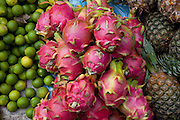 Luang Prabang, Laos. Morning food market. Limes, pineapple, and dragon fruit.
