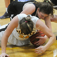 Trask's Rebecca Copper and Topsail's Keri White scramble for a loose ball Friday December 5, 2014 at Topsail High School in Hampstead, N.C. (Jason A. Frizzelle)