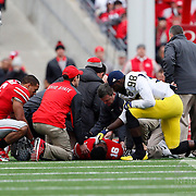 29 November 2014: Michigan Wolverines quarterback Devin Gardner (98) shows great sportsmanship and support for Ohio State Buckeyes quarterback J.T. Barrett (16) after a game ending injury during the game between the Ohio State Buckeyes and the University of Michigan Wolverines at Ohio Stadium in Columbus, OH