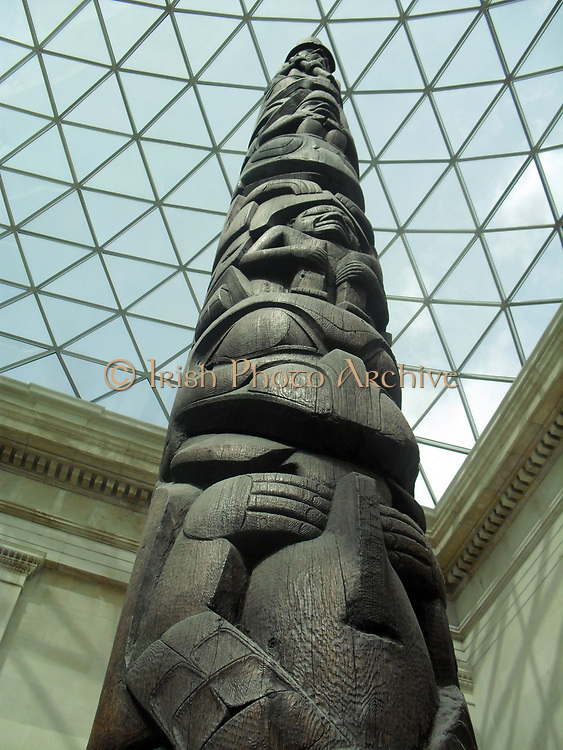 House frontal pole, Haida,  British Columbia, Canada, about 1850. Red cedar wood.  This 11 metre pole was originally set at the front of Goose or Bear House in the village of Kayang, on Masset Inlet.  It was purchased from Chief Wiah of Massett in 1903.  At that time the village of Kayang had already been abandoned after the local community was devastated by epidemics of introduced diseases.