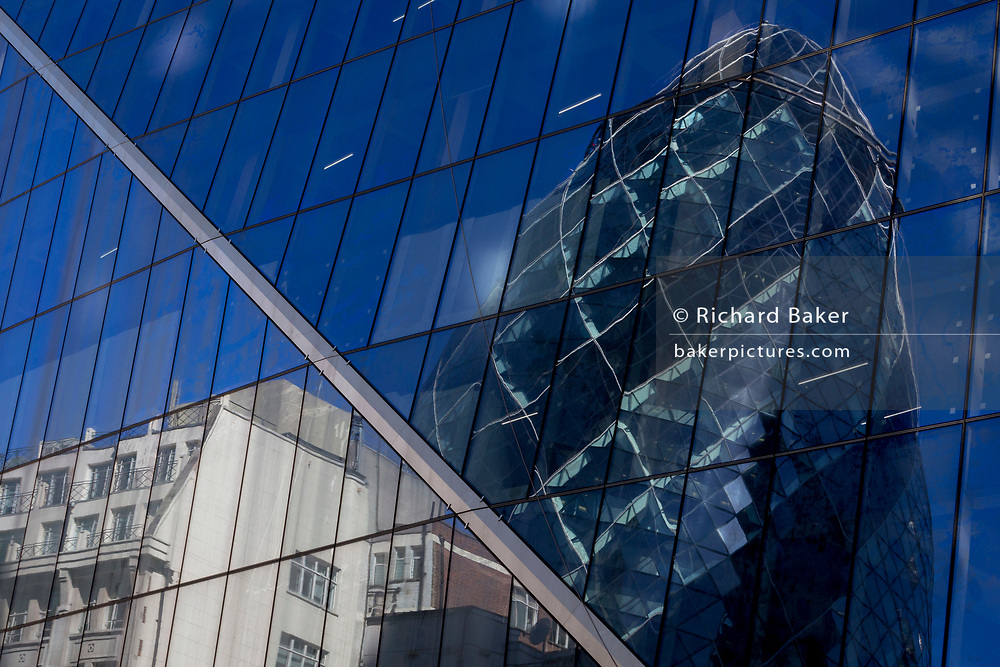 The reflections of the Swiss re tower (aka The Gherkin) in the City of London, the capital's historic financial district, on 2nd August 2018, in London, England.