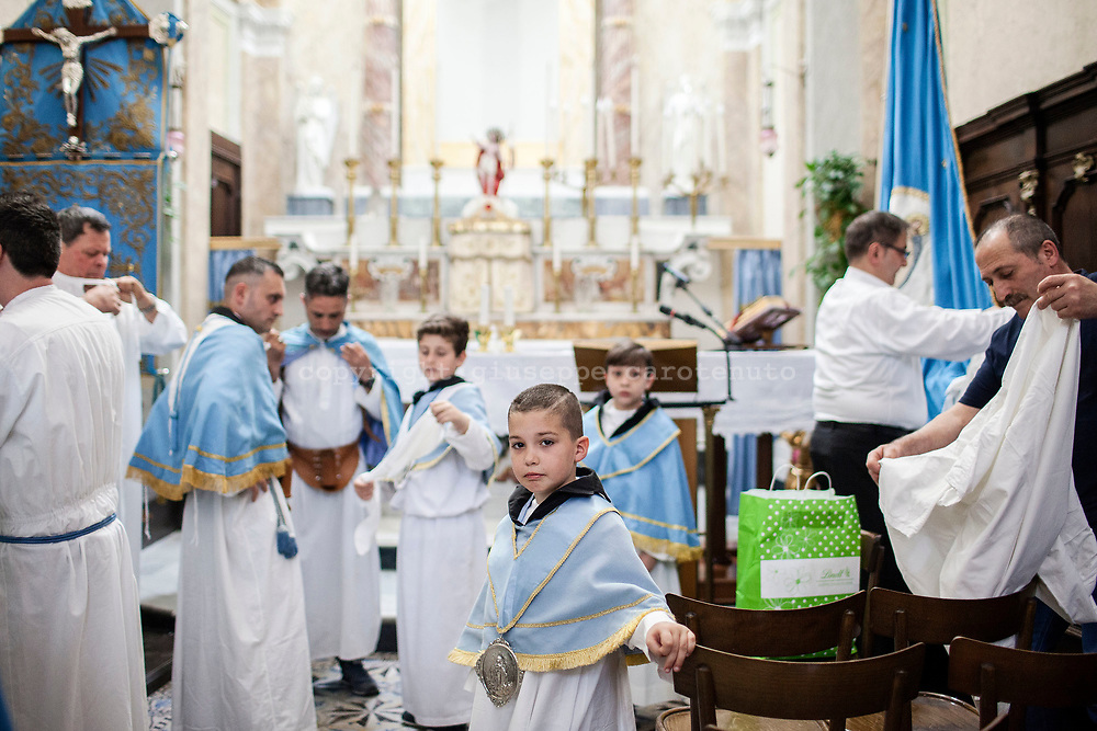 "21 May 2017, San Giorgio a Cremano, Naples Italy - Men's and children's preparing for the procession of the ""Festa della Lava"" inside the Real Arciconfraternita of the Immacolata."
