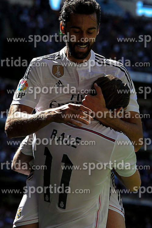 05.04.2015, Estadio Santiago Bernabeu, Madrid, ESP, Primera Division, Real Madrid vs FC Granada, 29. Runde, im Bild Real Madrid&acute;s Gareth Bale and Alvaro Arbeloa celebrates a goal // during the Spanish Primera Division 29th round match between Real Madrid CF and FC Granada at the Estadio Santiago Bernabeu in Madrid, Spain on 2015/04/05. EXPA Pictures &copy; 2015, PhotoCredit: EXPA/ Alterphotos/ Luis Fernandez<br /> <br /> *****ATTENTION - OUT of ESP, SUI*****