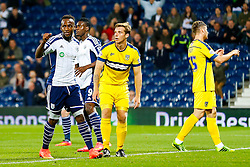 Saido Berahino of West Brom celebrates after an own goal for Johnny Mullins of Oxford United (pictured looking dejected) gives wb a 1-0 lead - Photo mandatory by-line: Rogan Thomson/JMP - 07966 386802 - 26/08/2014 - SPORT - FOOTBALL - The Hawthorns, West Bromwich - West Bromwich Albion v Oxford United - Capital One Cup Round 2.