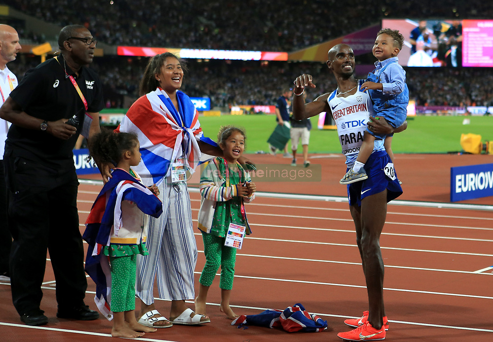 Great Britain's Mo Farah celebrates winning the men's 10,000 metre final with his children Amani, Aisha, Rhianna and Hussein Mo during day one of the 2017 IAAF World Championships at the London Stadium. PRESS ASSOCIATION Photo. Picture date: Friday August 4, 2017. See PA story ATHLETICS World. Photo credit should read: John Walton/PA Wire. RESTRICTIONS: Editorial use only. No transmission of sound or moving images and no video simulation.