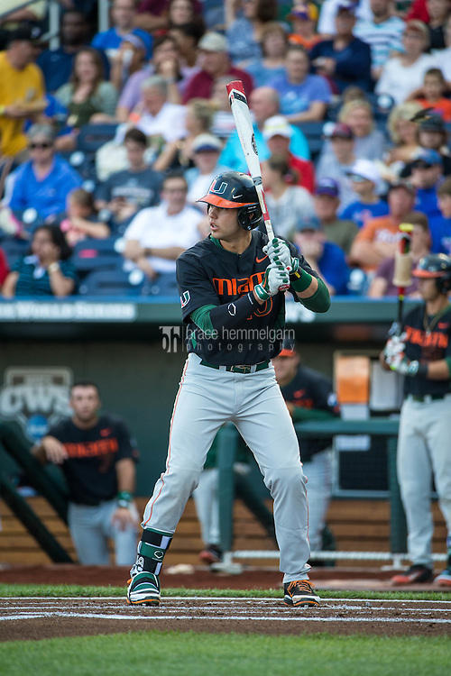 Garrett Kennedy (40) of the Miami Hurricanes bats during a game between the Miami Hurricanes and Florida Gators at TD Ameritrade Park on June 13, 2015 in Omaha, Nebraska. (Brace Hemmelgarn)