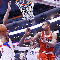 24 March 2014: Milwaukee Bucks guard Ramon Sessions (13) passes the ball around Los Angeles Clippers forward Danny Granger (33) during the Los Angeles Clippers 106-98 victory over the Milwaukee Bucks at the Staples Center, Los Angeles, California, USA.