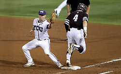 TCU's Connor Wanhanen (16) tags first base to put out Texas A&M's Nick Banks during the fourth inning of a NCAA college baseball Super Regional tournament game against TCU, Saturday, June 11, 2016, in College Station, Texas. Texas A&M won 7-1 to even the series at 1-1. (AP Photo/Sam Craft)