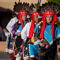 Brittney Edaakie, right, and the rest of the White Eagle Dancers perform a Supai dance during the Nightly Dances at the McKinley County Courthouse Plaza in Gallup Thursday. Dances began on Memorial Day and the will continue every evening until Labor Day.